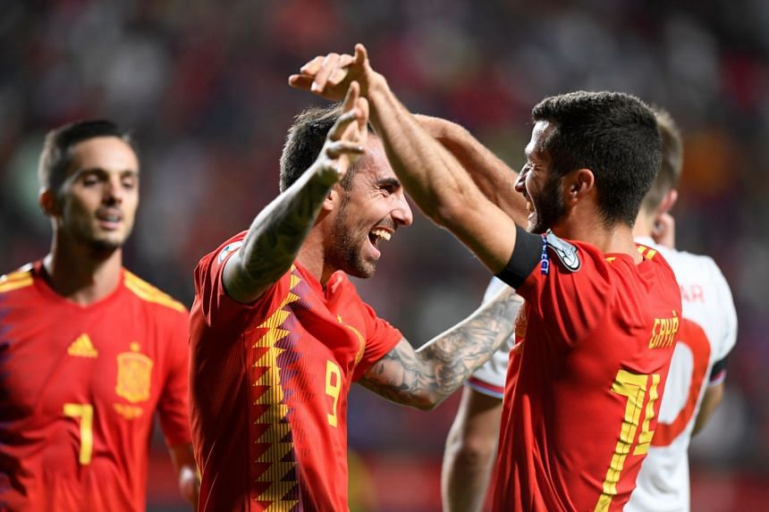 Spain's Paco Alcacer celebrates scoring their fourth goal with Jose Gaya.