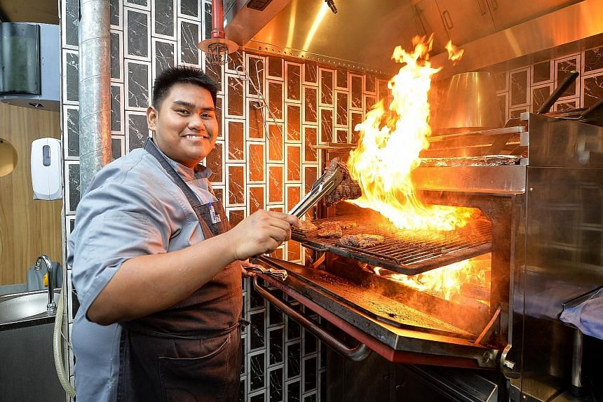 Chef Syahir Osman using the Mibrasa oven, which is designed to ensure that the airflow is constant and the temperature is kept regulated - and sparks do not land on the user.