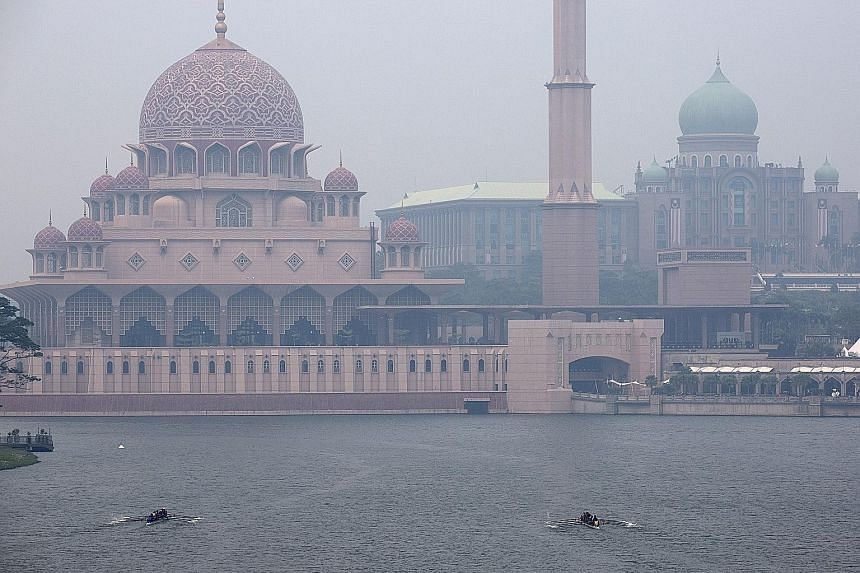Buildings in Putrajaya shrouded in haze yesterday. Several areas in Malaysia, especially on the west coast of the peninsula and west Sarawak, were affected by the haze due to the increase in hot spots in places like Sumatra, Indonesia.
