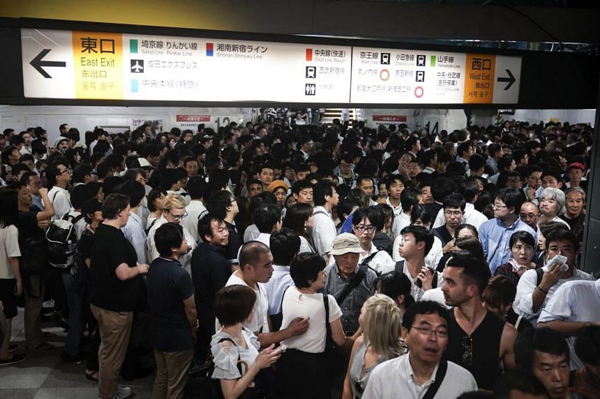 Commuters waiting for train platforms to open at Shinjuku Station, following some suspension of train services caused by Typhoon Faxai passing through the area in Tokyo, on Sept 9, 2019.