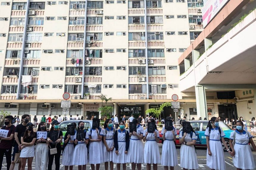 High school students and alumni form a human chain during a rally in the Sha Tin district of Hong Kong on Sept 9, 2019.