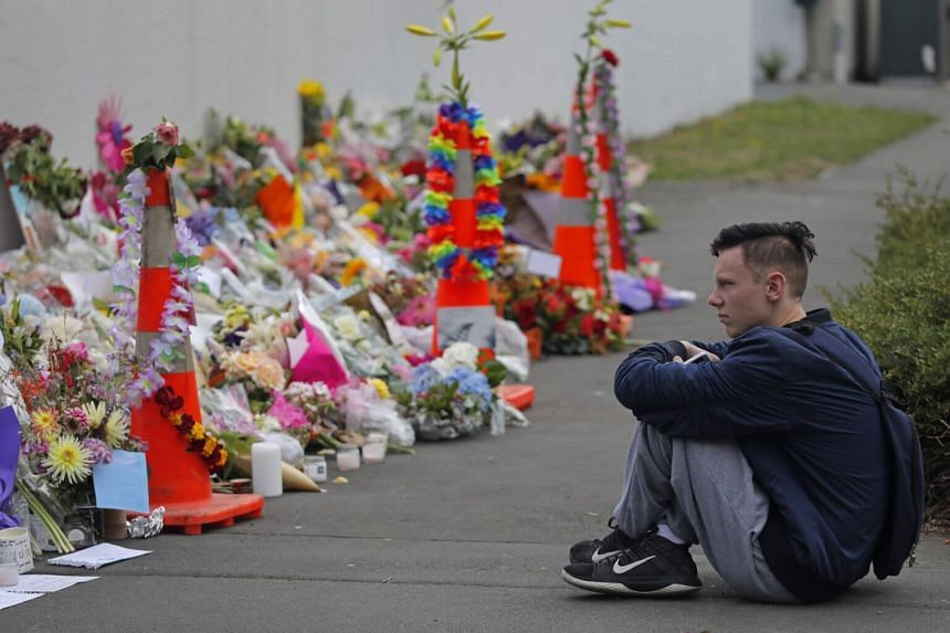 A student pays his respects at a park outside the Al Noor mosque in Christchurch, New Zealand, on March 18, 2019.