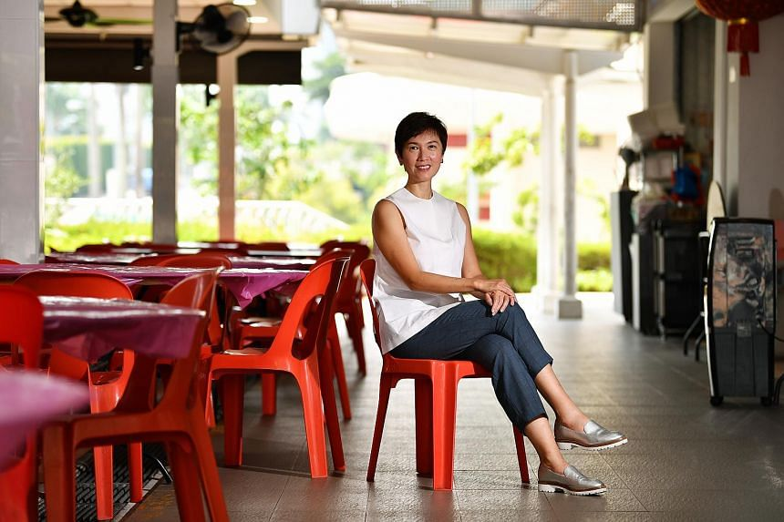 Manpower Minister Josephine Teo outside Two Chefs zi char eatery at Sin Ming Avenue. She is excited about upcoming developments in the area, including an MRT station and a community club.