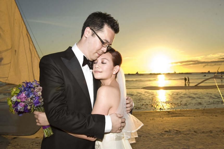 Malaysian singer Fish Leong hugging her then husband, Tony Chao, at their beach wedding held in Boracay in 2010.