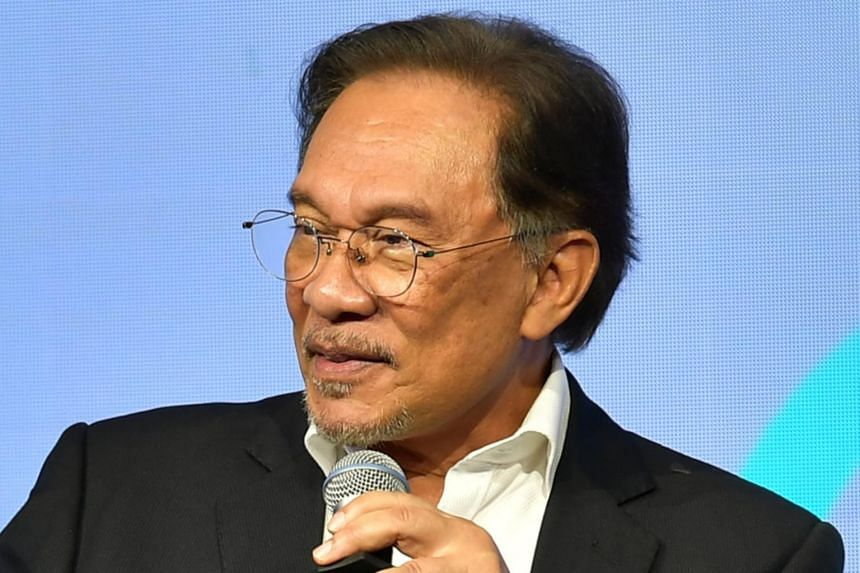 Anwar Ibrahim speaks during a plenary session in Singapore on April 26, 2019. He says the race-based New Economic Policy failed to address poverty even among the Malay community.