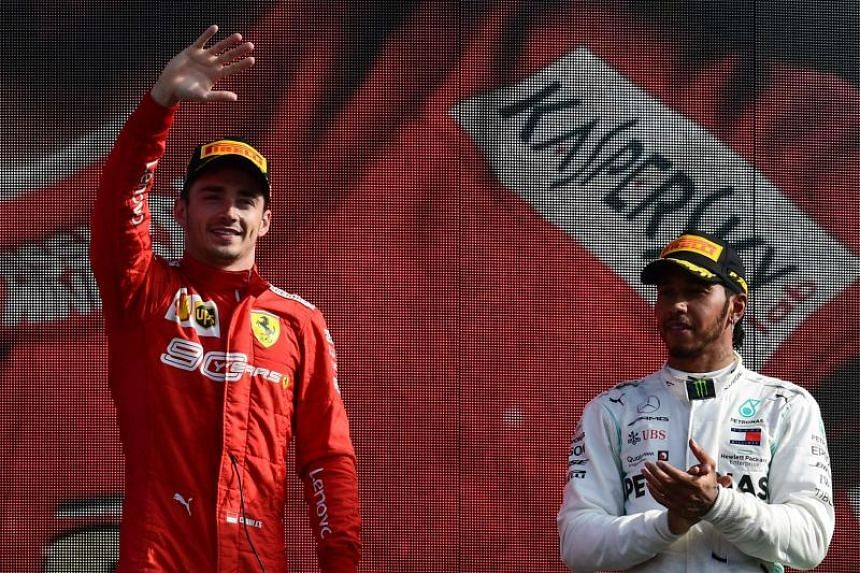 Ferrari's Charles Leclerc celebrates on the podium after winning the Italian Grand Prix, next to third-placed Lewis Hamilton of Mercedes in Monza on Sept 8, 2019.
