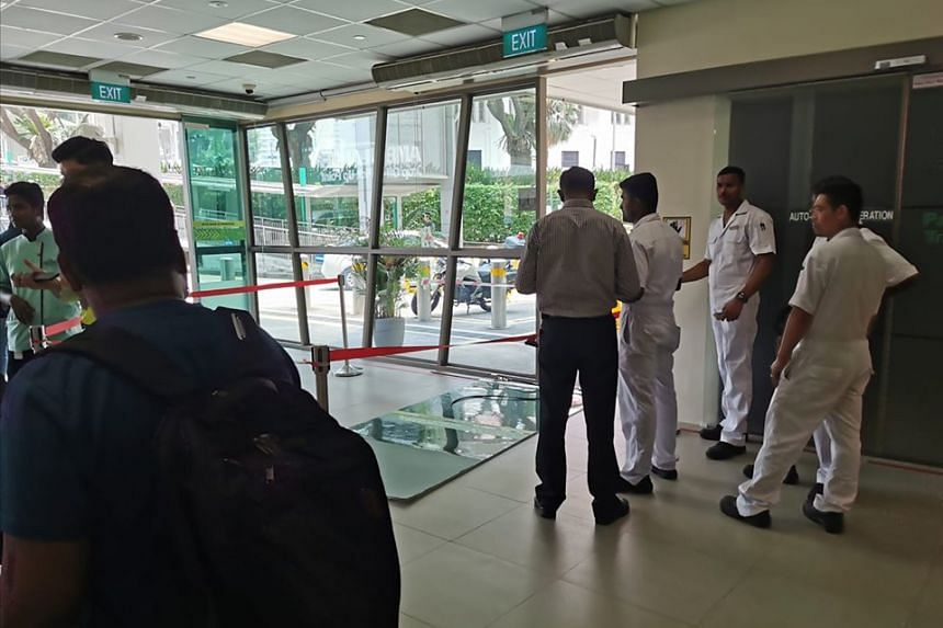 The door at the lobby of Block 5 in SGH fell when a visitor crashed into it while he was on the personal mobility aid on Sept 9, 2019.