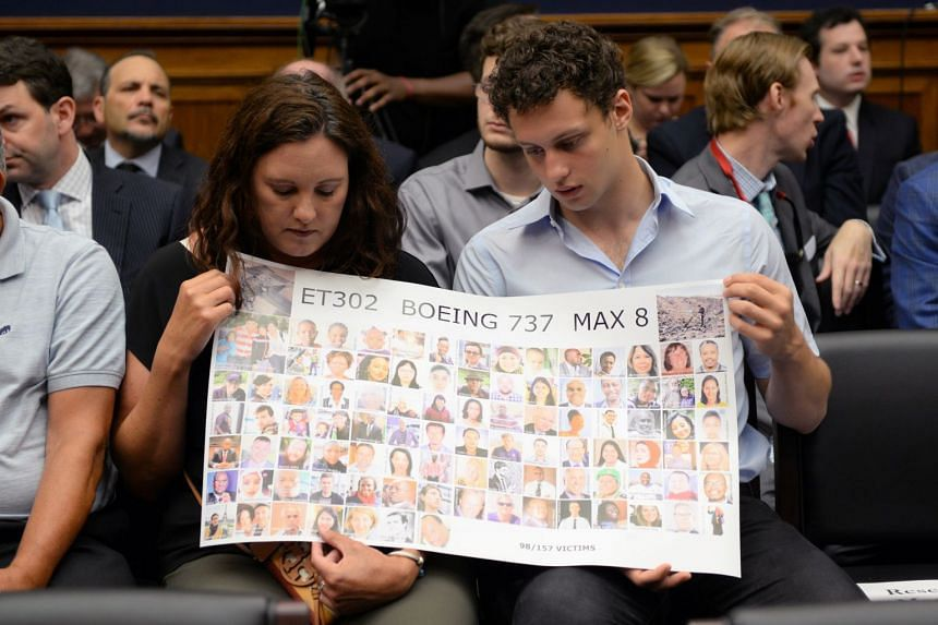 Tomra Vecere and Tor Stumo hold a poster of Ethiopian Airlines Flight 302 victims at a US hearing in July 2019.