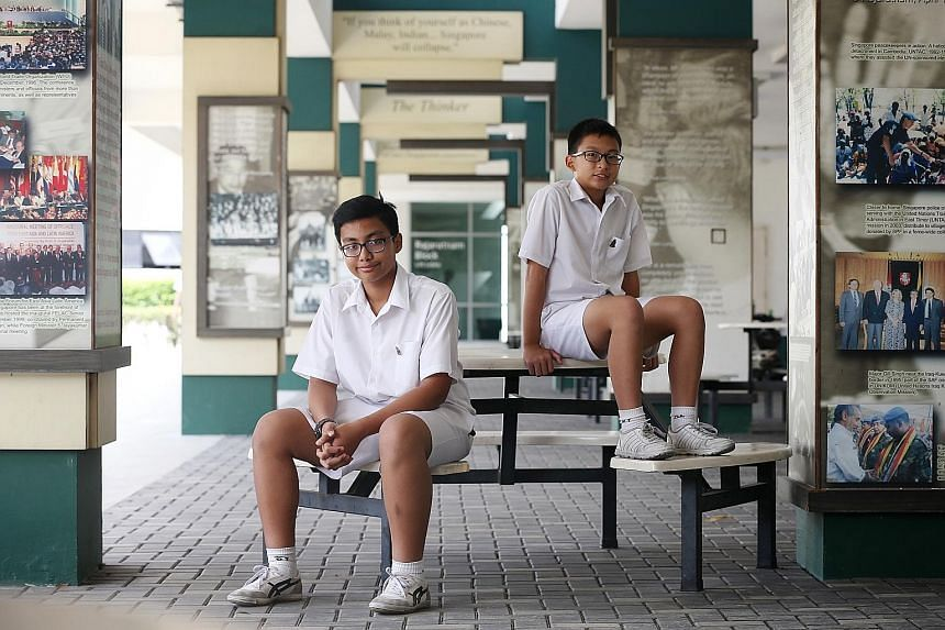 Raffles Institution students Muhammad Aqil Ahmad (left) and Joash Lim received the Raffles Scholarship in primary school and later entered RI. But they are the exception, as the number of scholarship recipients who go on to join the institution has r