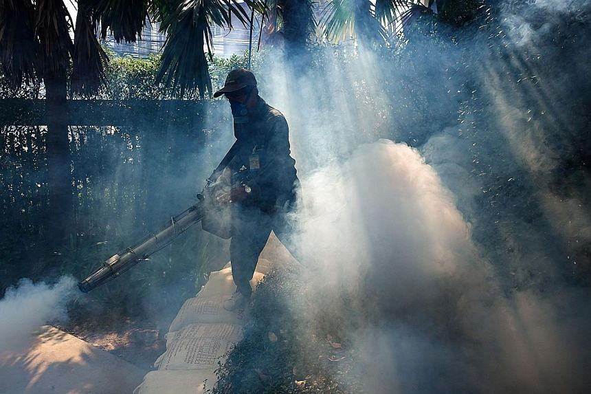 A worker spraying insecticide at a village in Bangkok in 2017. Malaria, which is spread by mosquitoes, infected about 219 million people in 2017 and killed around 435,000 of them. PHOTO: REUTERS