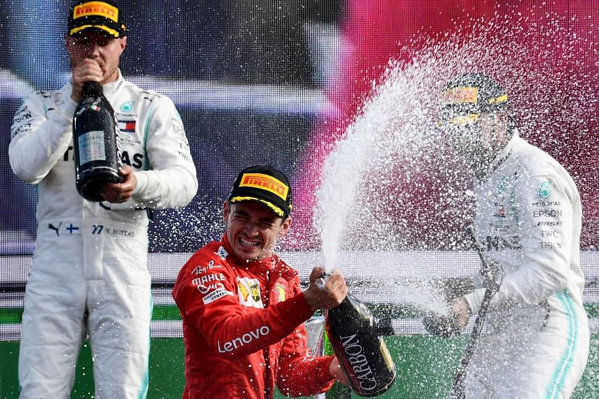 Mercedes' Lewis Hamilton (right) finished third at the Italian Grand Prix after chasing Charles Leclerc (centre) for most of the race. He attempted to overtake, but was forced onto the run-off by the Ferrari driver.
