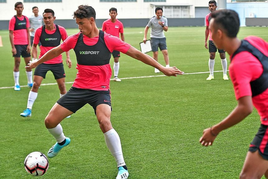 Ikhsan Fandi on the ball during training ahead of the World Cup qualifier against Palestine. The striker is relishing the opportunity of shouldering Singapore's scoring responsibilities at the tender age of 20.