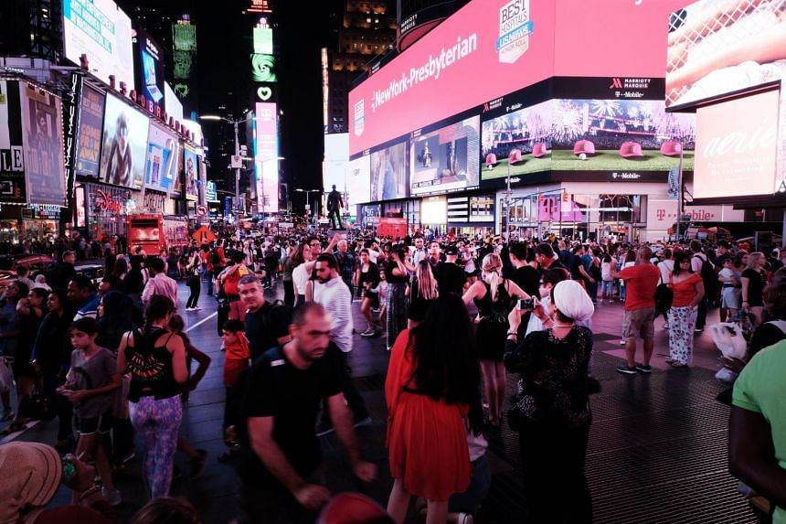Pedestrians walking through Times Square on Aug 8, 2019, in New York City.