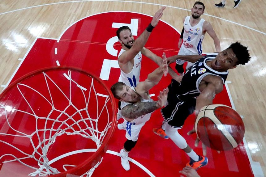 Greece's Giannis Antetokounmpo is defended by Czech Republic players in the Basketball World Cup Group K second-round game in Shenzhen on Sept 9, 2019. He fouled out as Greece won but failed to progress to the quarter-finals.