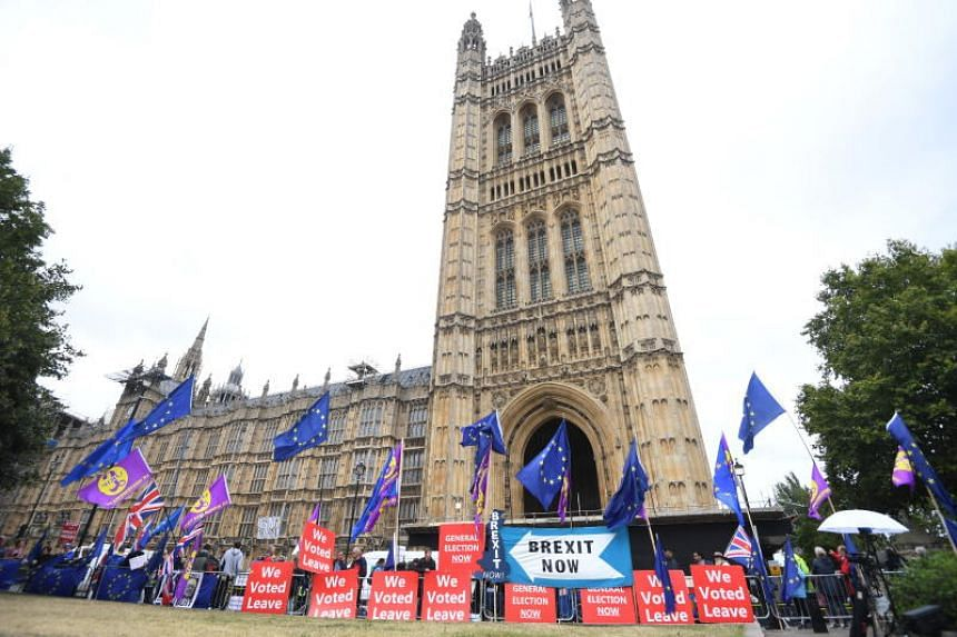 Anti and pro-Brexit protesters stand outside the Houses of Parliament in London on Sept 9, 2019.