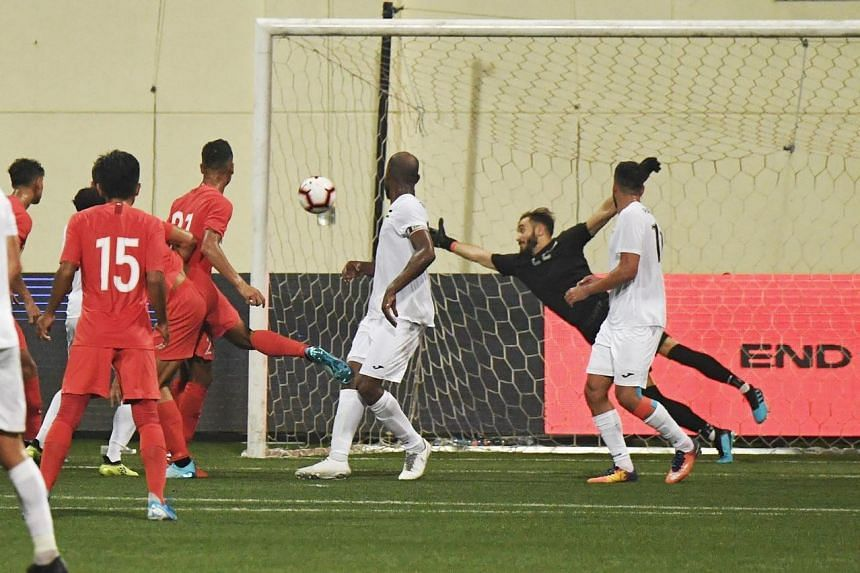Safuwan Baharudin (No. 21) heading home against Palestine to give Singapore a 2-1 lead just before half-time in their World Cup qualifier on Sept 10, 2019.
