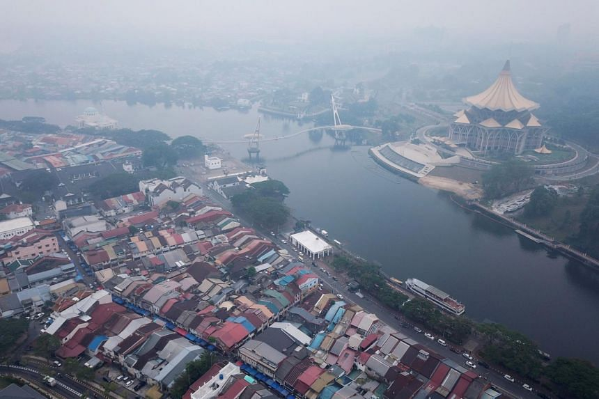 Haze shrouds the Sarawak Legislative Assembly building (right) in Kuching, the capital city of Sarawak state on the island of Borneo, on Sept 9, 2019.