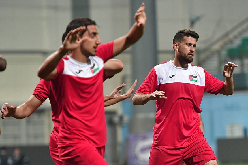 Midfielder Nazmi Albadawi (right), born in the United States, is one of the Palestinian players based overseas.