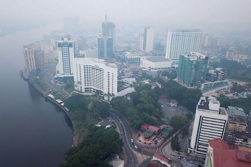 Haze shrouds the aerial view of Kuching, the capital city of Sarawak state on the island of Borneo on Sept 9, 2019.
