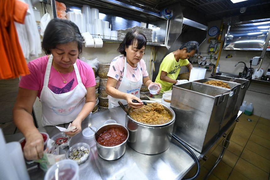 Employees prepare Chwee Kueh at Bedok Chwee Kueh stall at Bedok Interchange Hawker Centre on Sept 10, 2019.
