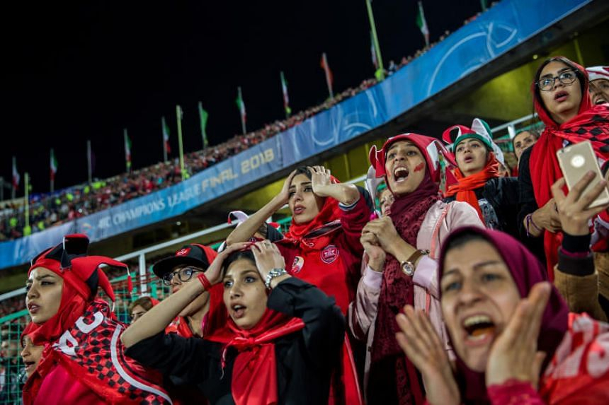 A photo taken on Nov 10, 2018, shows women watching the AFC Champions League Cup match between Iran's Persepolis and Japan's Kashima Antlers from a segregated section of a stand at the Azadi Stadium in Teheran.