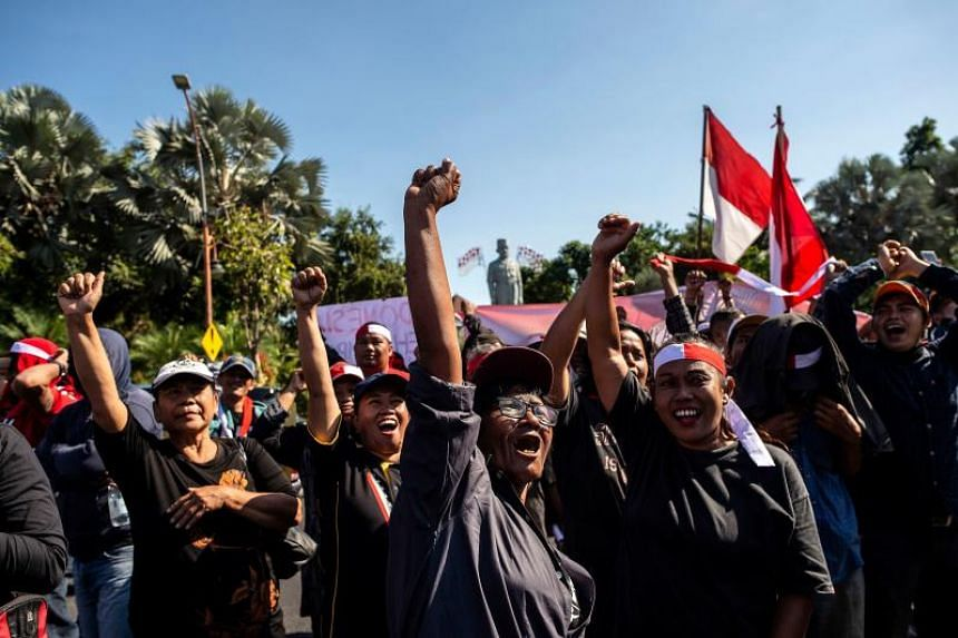 Indonesian activists gather in Surabaya on Sept 2, 2019, to promote peace in Indonesia's Papua region.
