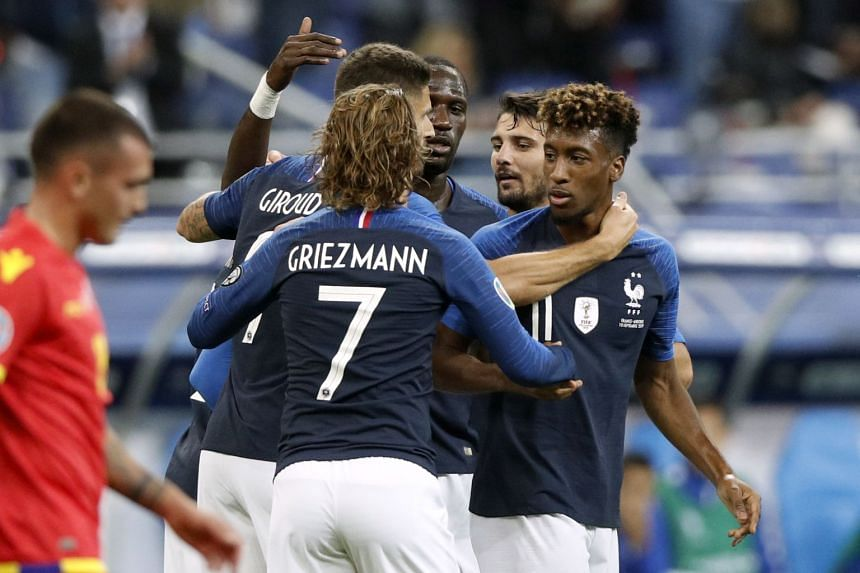 France's Kingsley Coman (right) celebrates with teammates after scoring the 1-0 lead.
