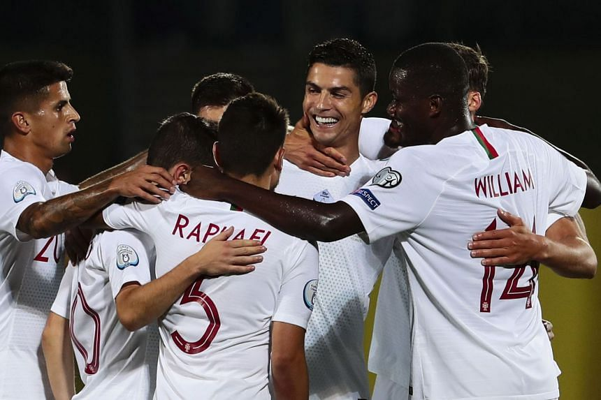 Image result for Cristiano Ronaldo scored four goals as Portugal beat Lithuania in Euro 2020 qualifying.