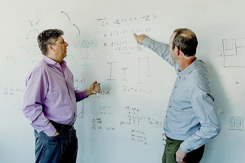 Dr Oren Etzioni (left) oversees the Allen Institute for Artificial Intelligence, which is behind Aristo, a new system that answered correctly more than 90 per cent of the questions on an eighth-grade science test. He is with Mr Peter Clark, manager o