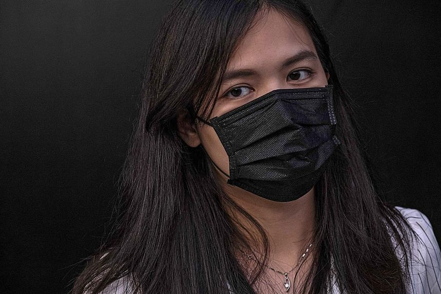 Sunny, a Hong Kong protester, has been taking to the streets to denounce the policies of China's central government. Her husband, a police officer, works 12-hour nightly shifts to confront the demonstrations.