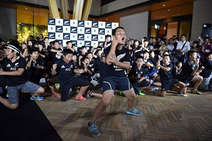 Japanese children perform the famous Haka during a welcome ceremony for the All Blacks upon the team's arrival at a hotel in Kashiwa, east of Tokyo, on Monday.