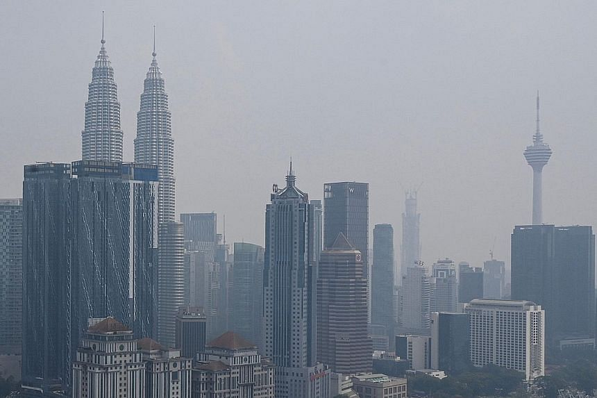 Parts of Malaysia, including Kuala Lumpur (above), have been affected by the haze. Energy, Science, Technology, Environment and Climate Change Minister Yeo Bee Yin said Malaysia will exhaust all diplomatic channels to get Indonesia to act to put out