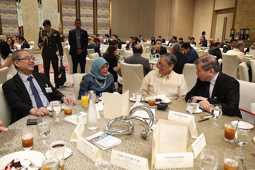 President Halimah Yacob with (from left) Mr Guillermo Luchangco from the Philippines-Singapore Business Council, Makati Business Club chairman Edgar Chua, and Singapore Business Federation chairman Teo Siong Seng at yesterday's 14th Philippines-Singa