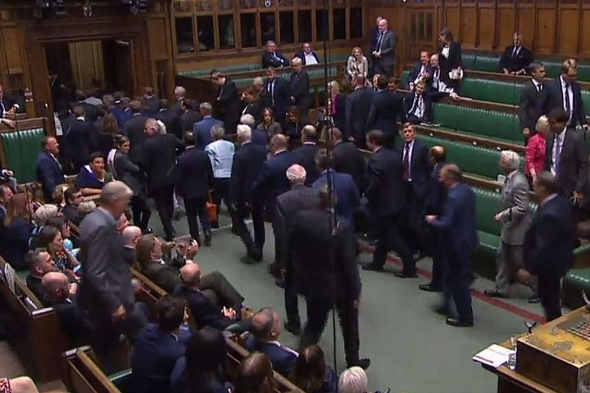 MPs leaving the House of Commons as the British Parliament was suspended yesterday until Oct 14. PHOTO: AGENCE FRANCE-PRESSE