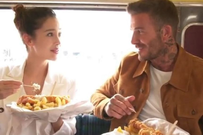 David Beckham and Chinese actress Angelababy were eating the iconic British food at the back of a bus, with Beckham, 44, telling Angelababy, 30, how, when he was young, he and his family used to get fish and chips wrapped in newspaper once a week, us