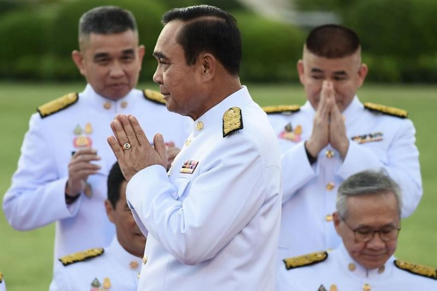 Thai Prime Minister Prayut Chan-o-cha (centre) and his 35 ministers pledged loyalty to the king as they recited the oath during a July 16 ceremony, but they omitted a phrase about upholding and complying with the Constitution.