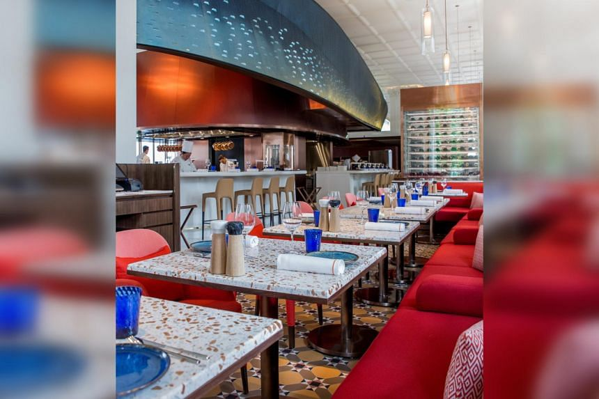 The 235-seater restaurant looks very Mediterranean, with the reds, blues and burnt orange hues because that is a part of the world French chef Alain Ducasse loves.