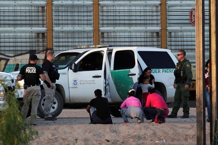 An immigrant family is detained by the US Customs and Border Protection officials after crossing illegally into the United States and turning themselves in to request for asylum in El Paso, Texas, as seen from Ciudad Juarez, Mexico on July 9, 2019.