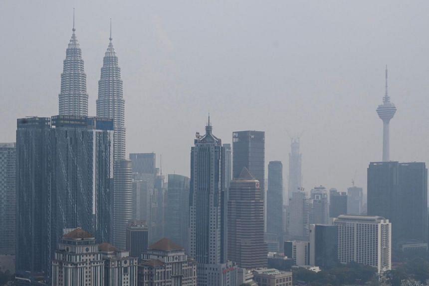 Malaysia's skyline with landmark Petronas Twin Towers and Kuala Lumpur Tower are seen shrouded in haze in Kuala Lumpur on Sept 10, 2019.