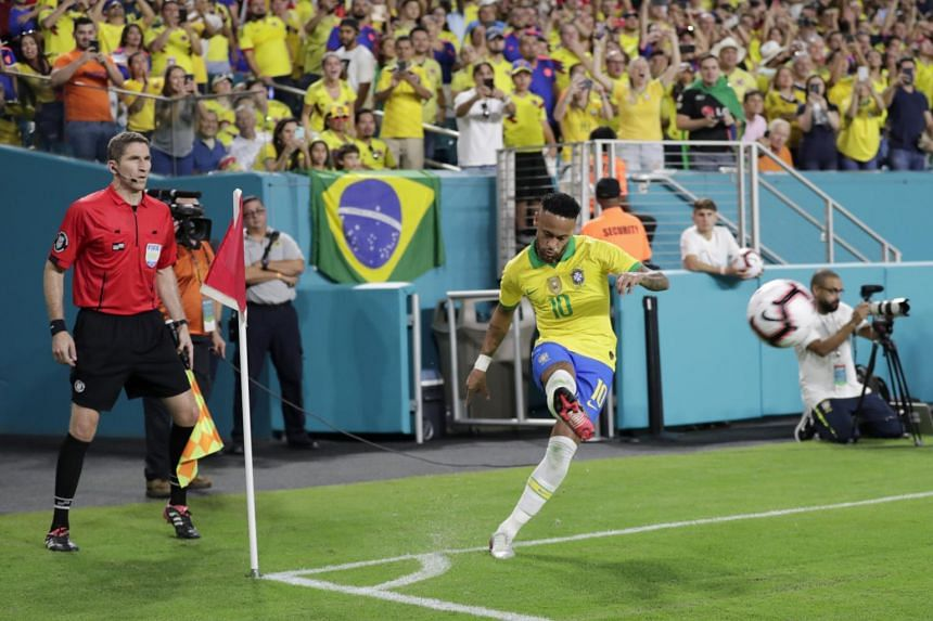 Brazil forward Neymar makes a corner kick for an assist on a goal scored by Casemiro during the first half of a friendly soccer match against Colombia, Sept 6, 2019.