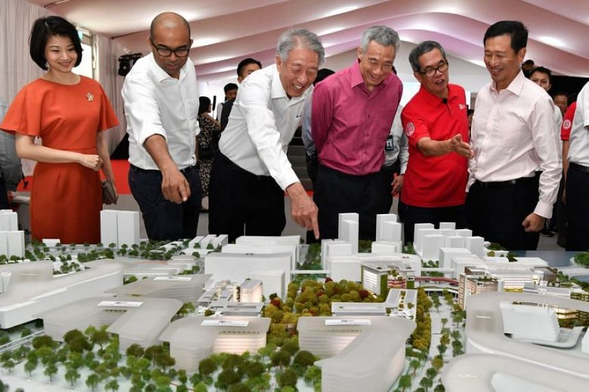 (From left) MP Sun Xueling, Senior Minister of State Janil Puthucheary, Senior Minister Teo Chee Hean, PM Lee Hsien Loong, Prof Tan Thiam Soon and Education Minister Ong Ye Kung looking at the model of the future SIT campus at the ground-breaking cer