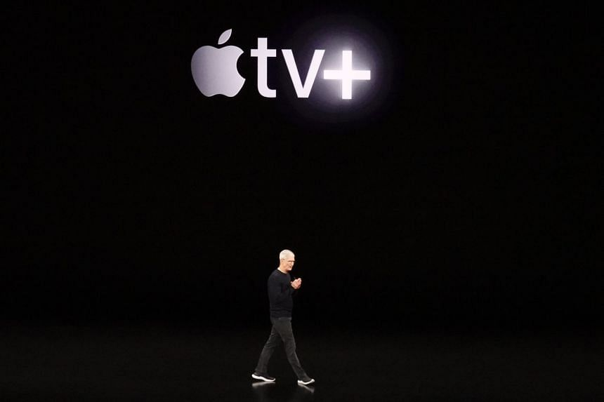 Apple CEO Tim Cook announcing the availability of Apple TV+ video content streaming service at a media event at the Steve Jobs Theatre on the Apple Park campus.