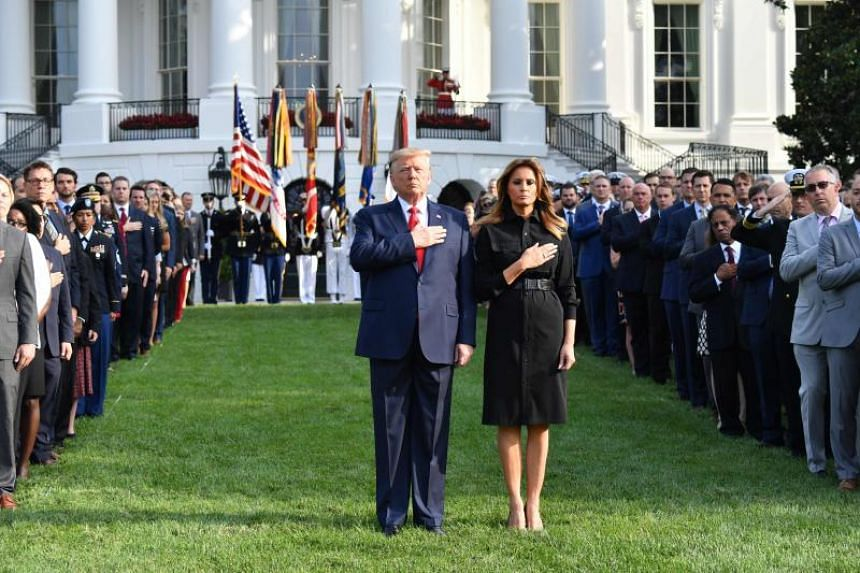 US President Donald Trump and First Lady Melania Trump observe a moment of silence on the South Lawn of the White House to mark the 18th anniversary of the 9/11 attacks, on Sept 11, 2019, in Washington, DC.