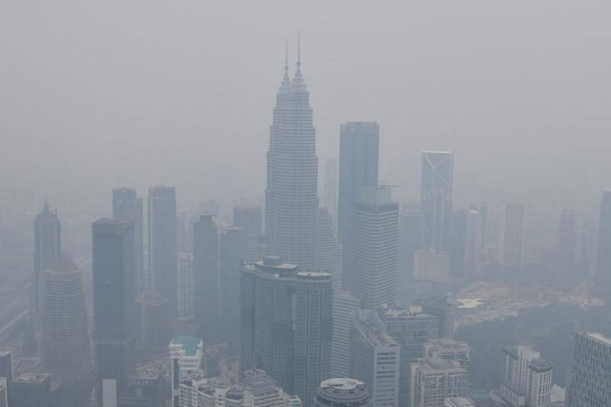 The Kuala Lumpur skyline is seen shrouded in haze on Sept 11, 2019.