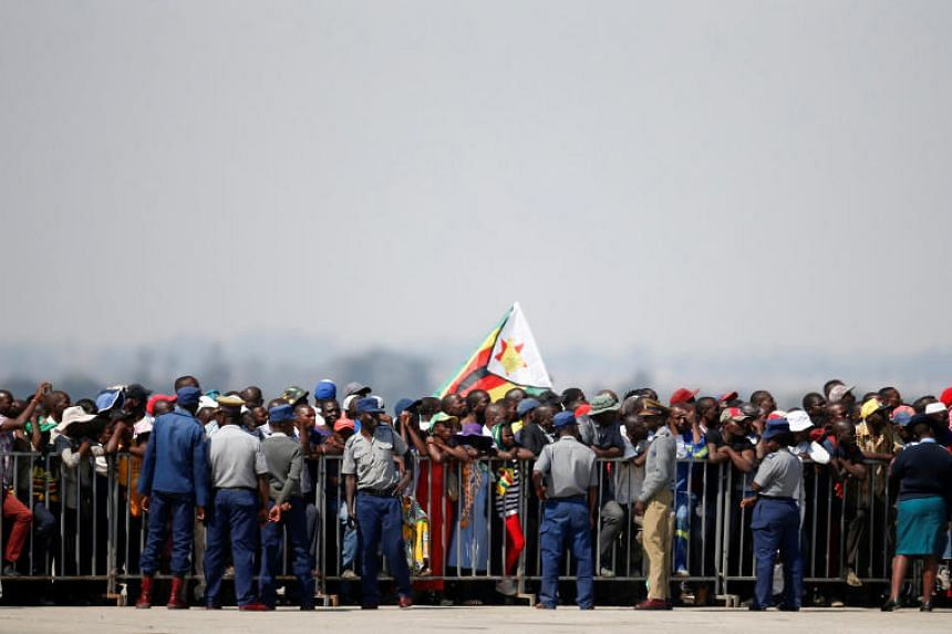 Zimbabweans wait for the arrival of the body of former president Robert Mugabe to the country after he died on Sept 6, 2019, in Singapore after a long illness.
