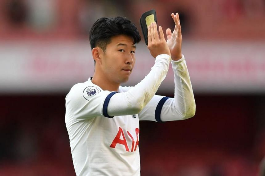South Korean striker Son Heung-min applauds supporters on the pitch after the match between Arsenal and Tottenham Hotspur at the Emirates Stadium on Sept 1, 2019.