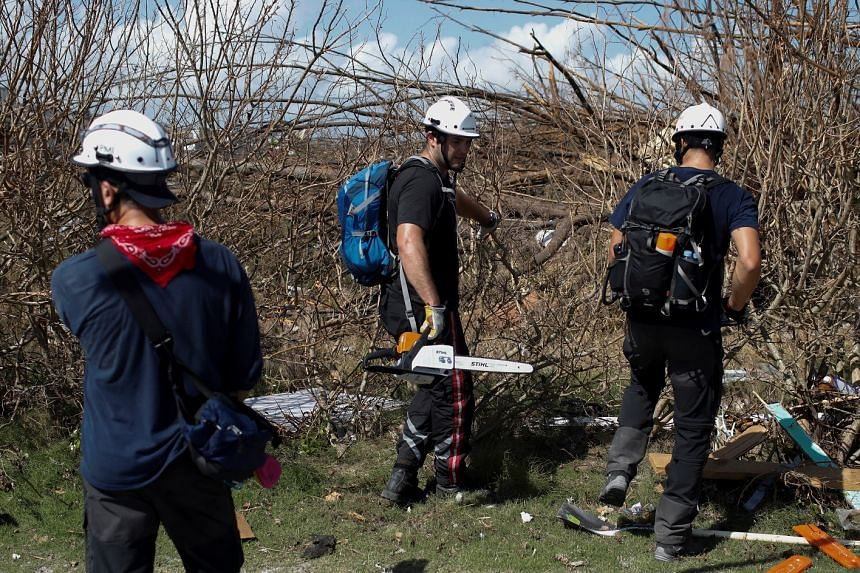 Members of the Canadian Burnaby Firefighters Search & Rescue Task Force search for victims.
