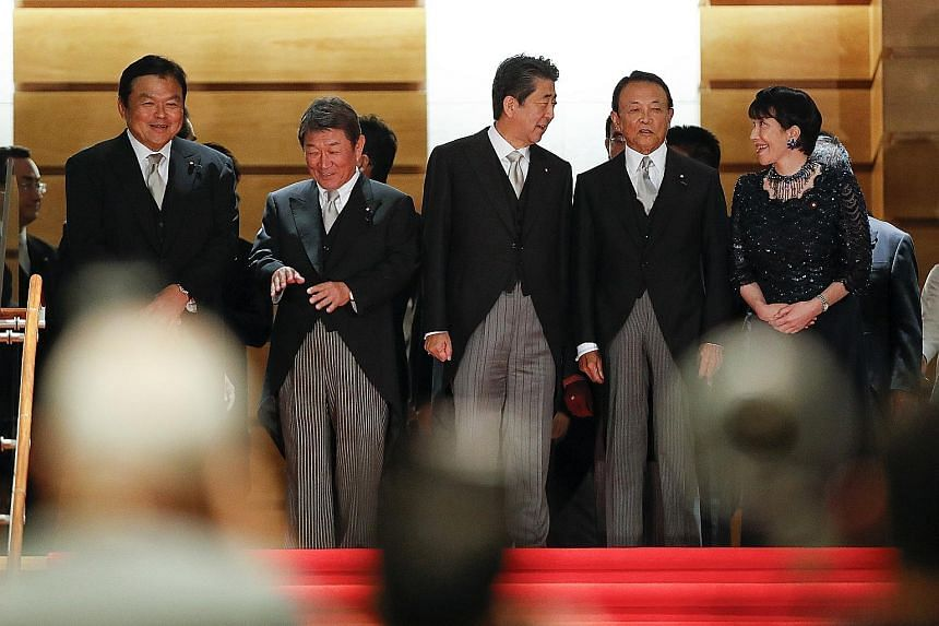 Members of Japan's new Cabinet include (from left) Land, Infrastructure, Transport and Tourism Minister Kazuyoshi Akaba, Foreign Minister Toshimitsu Motegi, Prime Minister Shinzo Abe, Finance Minister Taro Aso and Internal Affairs Minister Sanae Taka