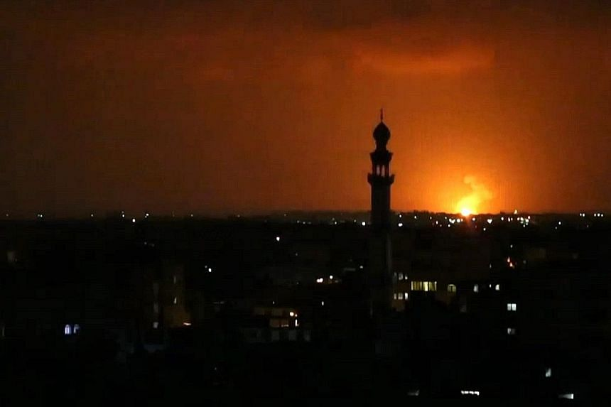 An explosion from an Israeli air strike near Deir el-Balah in the central Gaza Strip, in response to rockets fired towards Israel.