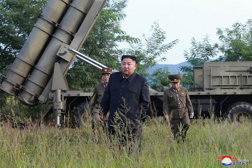 A photo from the North Korean government showing leader Kim Jong Un visiting a multiple rocket launcher site at an undisclosed location on Tuesday. North Korea fired a new round of short-range projectiles into its eastern seas that flew about 330km o